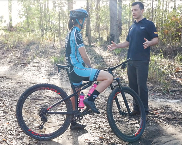 Chris Pomfret communicating with legendary mountain bike coach Donna Dall.